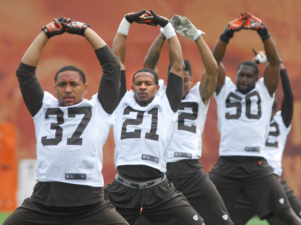 . Michael Allen Blair/Digital First Media Browns\' defensive backs Josh Aubrey (37), and Justin Gilbert (21) stretch with teammates during organized team activities on May 21 in Berea.