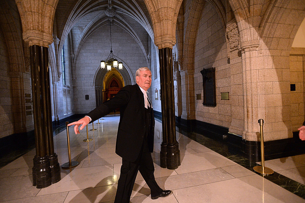 . Kevin Vickers, sergeant-at-arms of the House of Commons, walks Thursday Oct. 23, 2014 past the library where Michael Zehaf Bibeau was gunned down the day before, in Ottawa, Ontario. Zehaf-Bibeau killed a soldier standing guard at Canada\'s war memorial Wednesday, then stormed Parliament in an attack that was stopped cold when he was shot to death by Vickers. (AP Photo/The Canadian Press, Sean Kilpatrick)