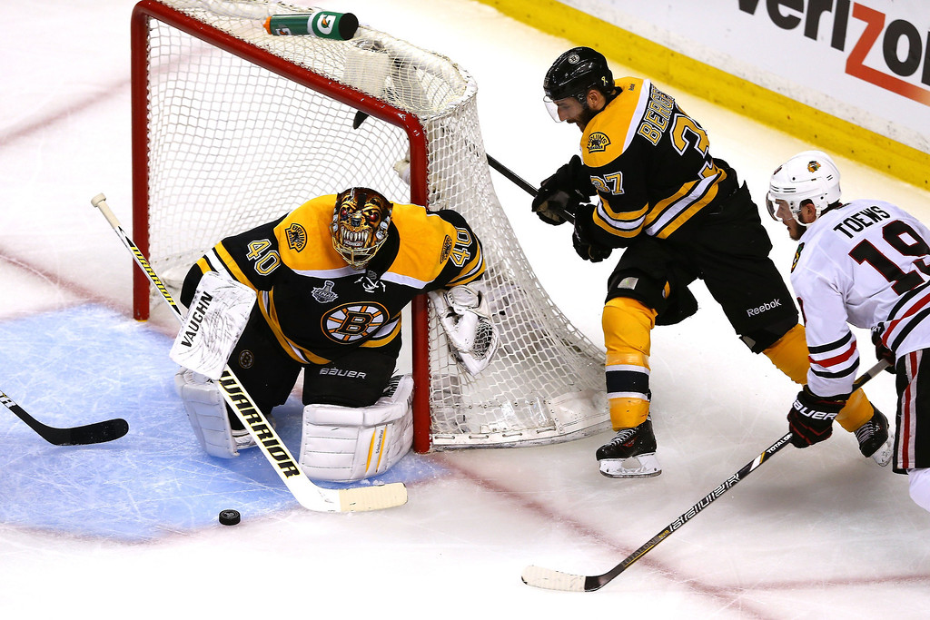 . Jonathan Toews #19 of the Chicago Blackhawks tries a shot on goal against Tuukka Rask #40 of the Boston Bruins in Game Three of the 2013 NHL Stanley Cup Final at TD Garden on June 17, 2013 in Boston, Massachusetts.  (Photo by Elsa/Getty Images)