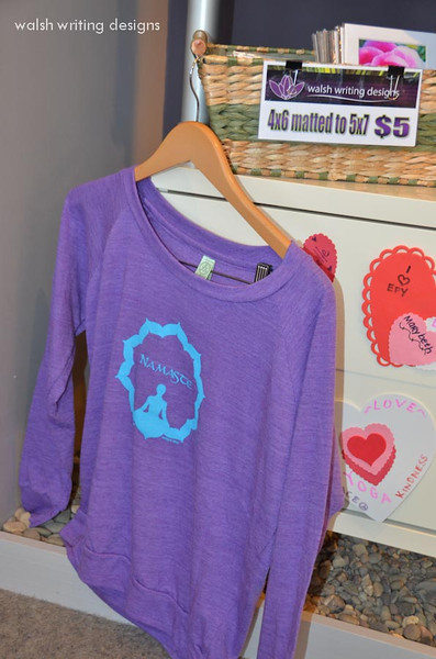 Purple slouchy pullover with Namaste design in turquoise centered on the front