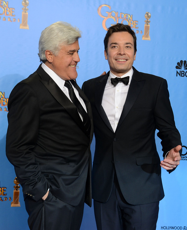 ". File- This Jan. 13, 2013, file photo shows presenters Jimmy Fallon, left, and Jay Leno posing backstage at the 70th Annual Golden Globe Awards at the Beverly Hilton Hotel  in Beverly Hills, Calif. Leno will close out his 22-year run as host of NBC\'s ""The Tonight Show\"" with a nod to the future and to the past. His heir apparent, Fallon, will kick off Leno\'s final week with a guest appearance on Feb. 3. Fallon is taking over the gig after hosting NBC\'s \""Late Night\"" since 2009. (Photo by Jordan Strauss/Invision/AP)"