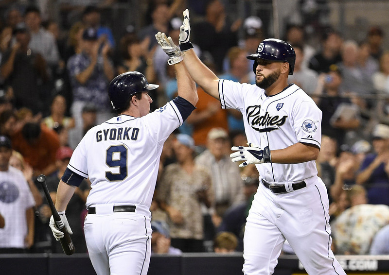 . Yonder Alonso #23 of the San Diego Padres, right, is congratulated by Jedd Gyorko #9 after he hit a solo home run during the fourth inning of a baseball game against the Colorado Rockies at Petco Park August, 11, 2014 in San Diego, California.  (Photo by Denis Poroy/Getty Images)