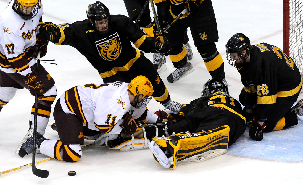 . The pucks gets away from Gophers\' Sam Warning (11) and Colorado College goaltender Joe Howe (31) at the net during the second period of the WCHA Final Five at the Xcel Energy Center Arena on March 22, 2013. (Pioneer Press: Sherri LaRose-Chiglo)