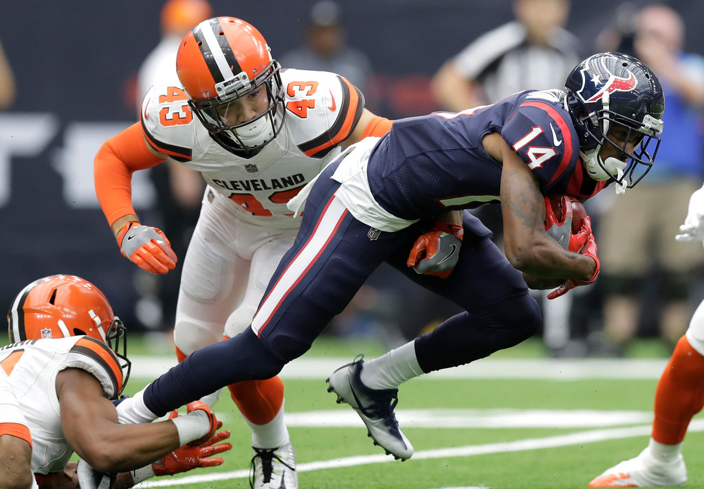 . Houston Texans wide receiver Chris Thompson (14) attempts to gain yardage after catching a pass as Cleveland Browns defensive back Kai Nacua (43) attempts the stop in the first half of an NFL football game, Sunday, Oct. 15, 2017, in Houston. (AP Photo/Eric Gay)