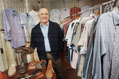 Seattle-based Tommy Bahamas chief executive Doug Wood shows of some of his company's 2015 product line