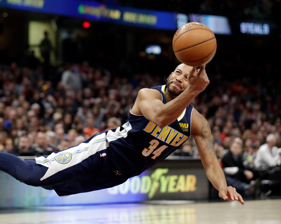 . Denver Nuggets\' Devin Harris (34) shoots against the Cleveland Cavaliers in the second half of an NBA basketball game, Saturday, March 3, 2018, in Cleveland. (AP Photo/Tony Dejak)