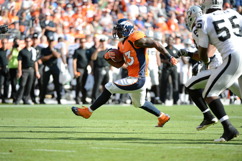 . The Broncos running back Willis McGahee makes a run in the third quarter during the Denver Broncos game against the Oakland Raiders at Sports Authority Field at Mile High on Sunday, September 30, 2012. John Leyba, The Denver Post