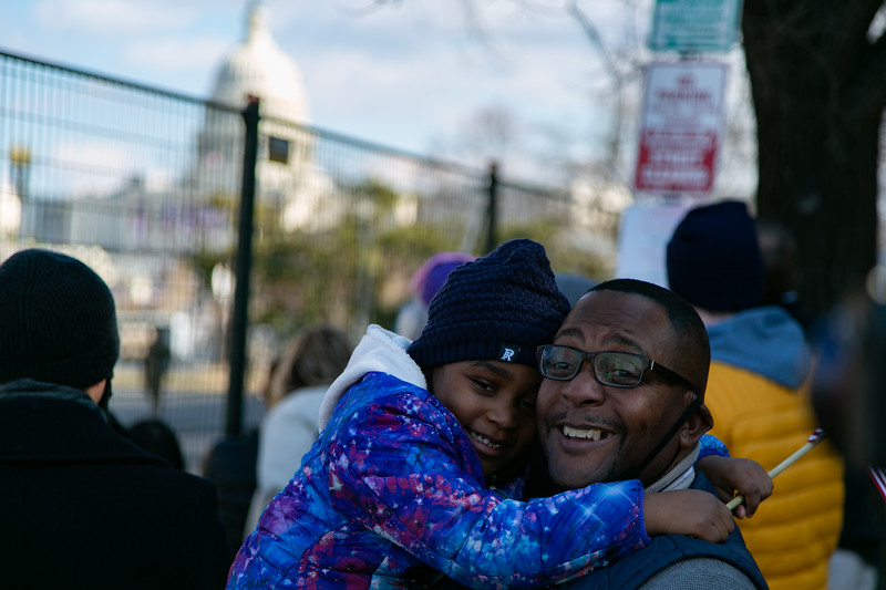 A man and child gather near the U.S. Capitol to celebrate inauguration