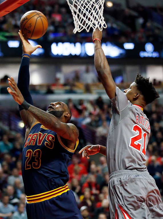 . Cleveland Cavaliers forward LeBron James, left, shoots against the Chicago Bulls guard/forward Jimmy Butler during the first half of an NBA basketball game Thursday, March 30, 2017, in Chicago. (AP Photo/Nam Y. Huh)