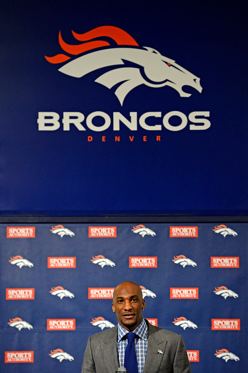 . Denver Broncos Aqib Talib smiles at the podium during a press conference March 12, 2014 at Dove Valley. (Photo by John Leyba/The Denver Post)