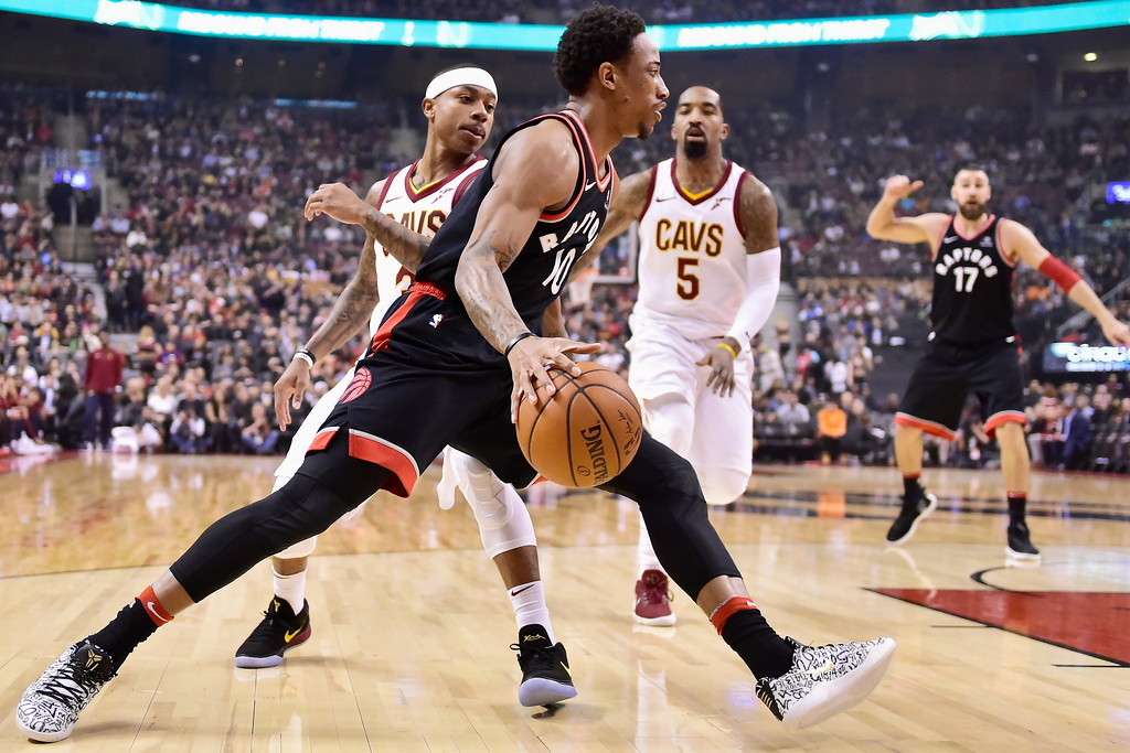 . Toronto Raptors guard DeMar DeRozan (10) drives to the basket against Cleveland Cavaliers guard Isaiah Thomas, left, during the first half of an NBA basketball game Thursday, Jan. 11, 2018, in Toronto. (Frank Gunn/The Canadian Press via AP)