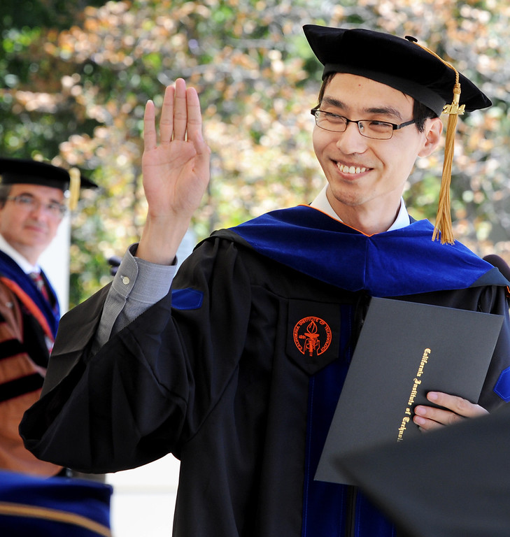 . Wei Wei waving to a Caltech professor as he receives a Doctor of Philosphy degree in Material Science and also received the Milton and Francis Clauser Doctoral Prize, that is awarded to the PhD candidate whose research is judged to exhibit the greatest degree of originality as evidenced by its potential for opening up new avenues of human thought and endeavor as well as by the ingenuity with which it has been carried out.  His research was cancer research at the 120th Annual Commencement at California Institute of Technology Friday, June 13, 2014.(Photo by Walt Mancini/Pasadena Star-News)