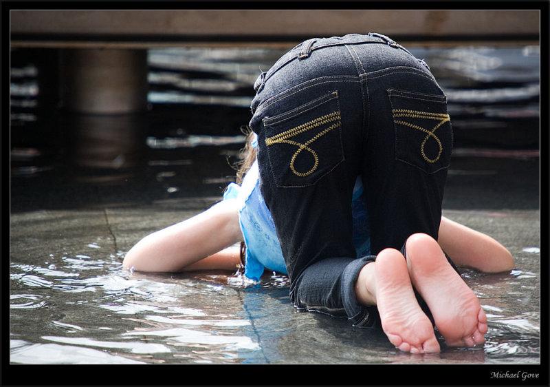 Girl playing hide n seek in the water (83020417).jpg