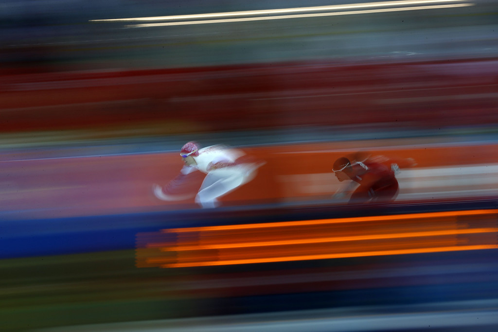 . Russia\'s Denis Yuskov (L)and Norway\'s Sverre Lunde Pedersen compete in the Men\'s Speed Skating 1500 m at the Adler Arena during the Sochi Winter Olympics on February 15, 2014.  ADRIAN DENNIS/AFP/Getty Images
