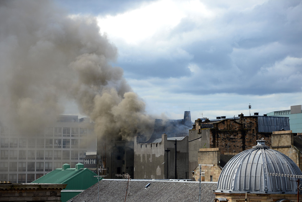 . Smoke rises into the sky after a fire broke out at the Glasgow School of Art Charles Rennie Mackintosh Building on May 23, 2014 in Glasgow, Scotland. The fire at the A-listed building is said to have started in the basement after a projector exploded. The school has stated that all students and staff were evacuated safely. (Photo by Jeff J Mitchell/Getty Images)