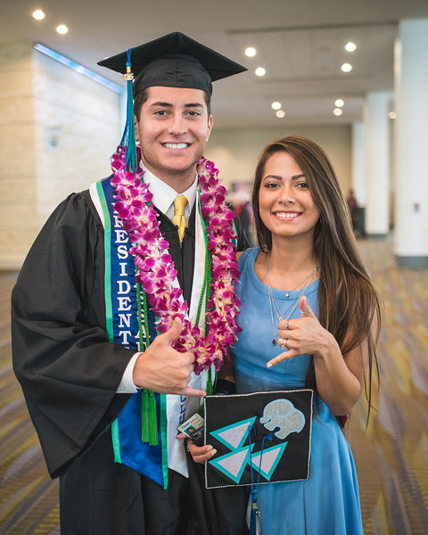 Brody Hajebian and Maria Andrade pose for a photo as they make their way to the 2016 Spring Commencement ceremony.More Photos: https://flic.kr/s/aHskwtWSi2
