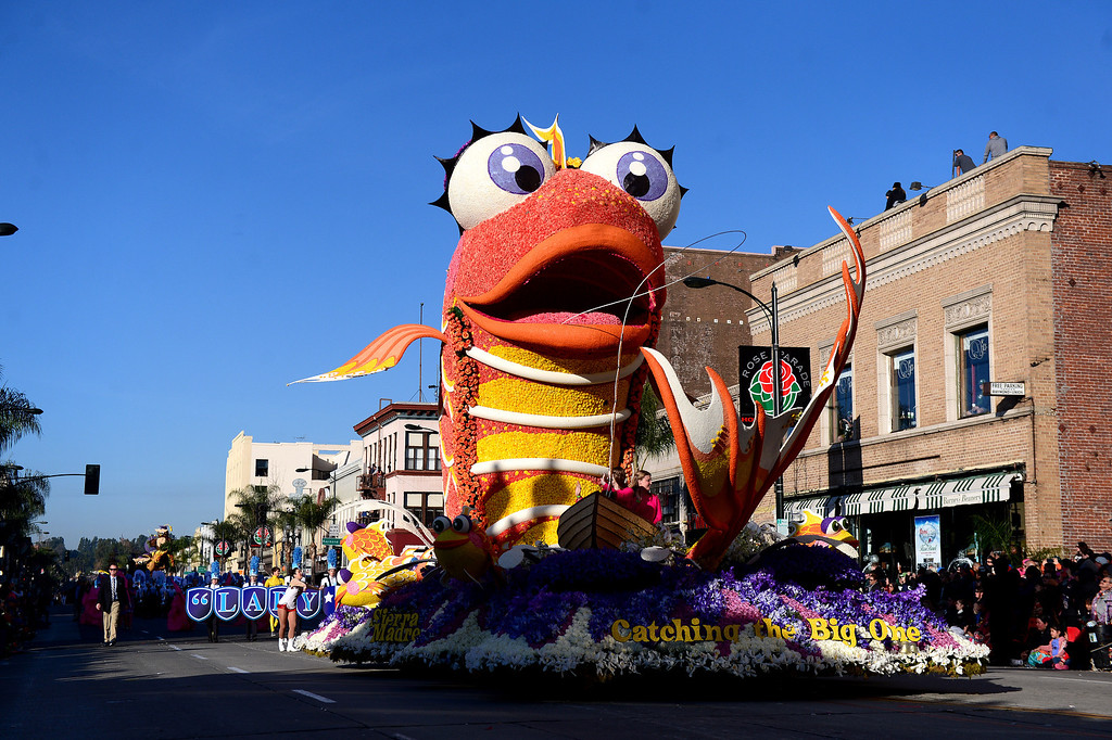 ". Sierra Madre Rose Float Association\'s ""Catching the Big One\"" float heads down Colorado Boulevard during the 125th Rose Parade in Pasadena, CA January 1, 2014. (Photo by Sarah Reingewirtz/Pasadena Star-News)"