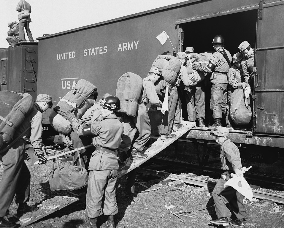 . Korea war communist prisoner exchange non repatriates released, Jan. 20, 1954 the North Korean prisoners Load into the flat cars which ill take them southward to the reception centers after they came across from the DZ to the U.N. Receiving point. (AP Photo/Sweers)