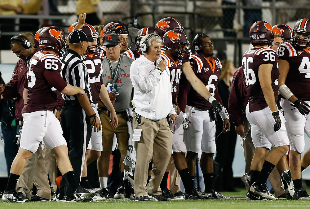 Description of . Head coach Frank Beamer of the Virginia Tech Hokies directs his team against the Rutgers Scarlet Knights during the Russell Athletic Bowl Game at the Florida Citrus Bowl on December 28, 2012 in Orlando, Florida.  (Photo by J. Meric/Getty Images)