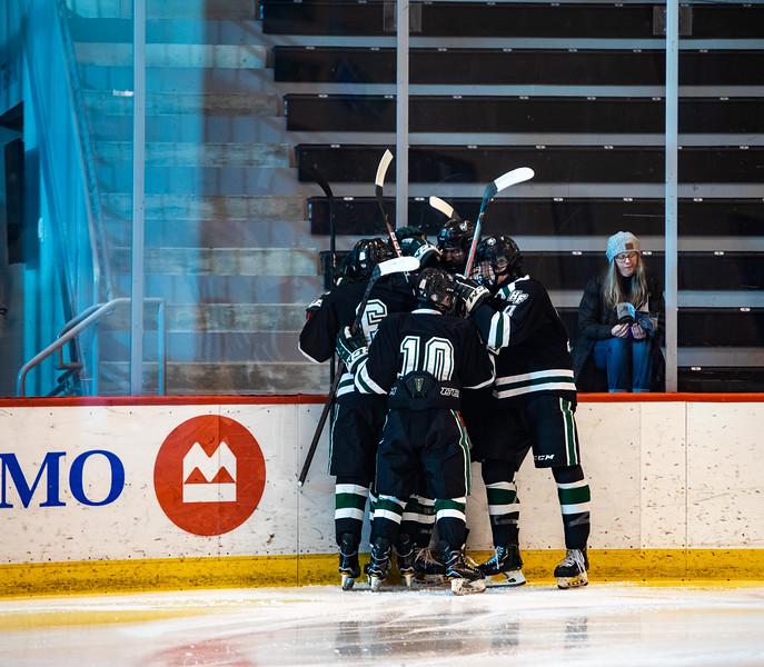 Holy Family Boys Varsity Hockey vs. Academy of Holy Angels, 12/21/19: Holy Family celebrates scoring a goal.