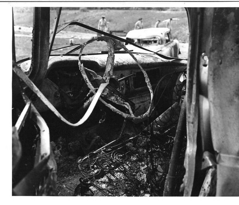 Close up of damage to Government vehicle.  22 May 1958.