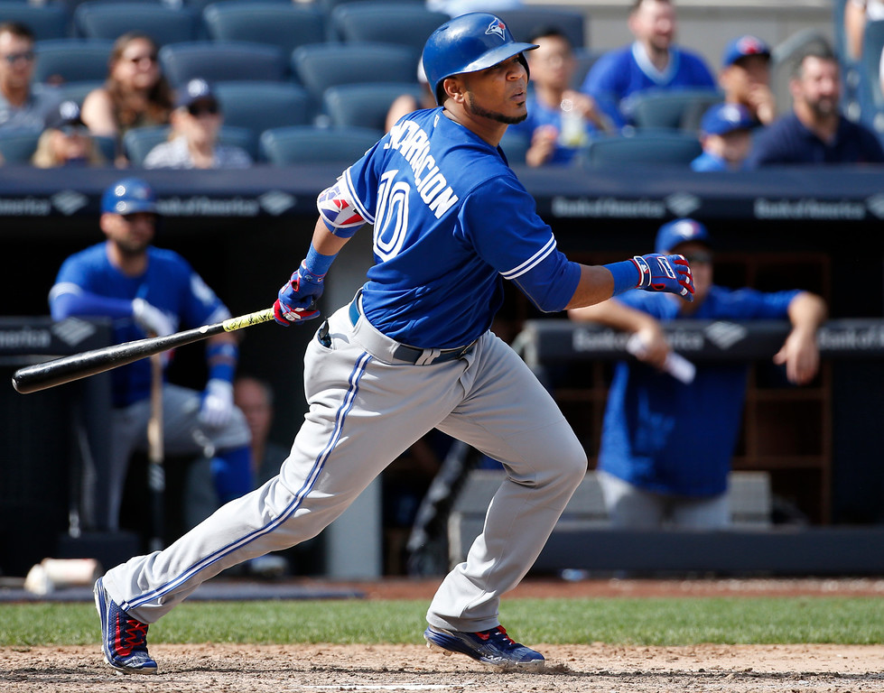 . Toronto Blue Jays\' Edwin Encarnacion hits a two-run single during the seventh inning of a baseball game in New York, Monday, Sept. 5, 2016. (AP Photo/Kathy Willens)