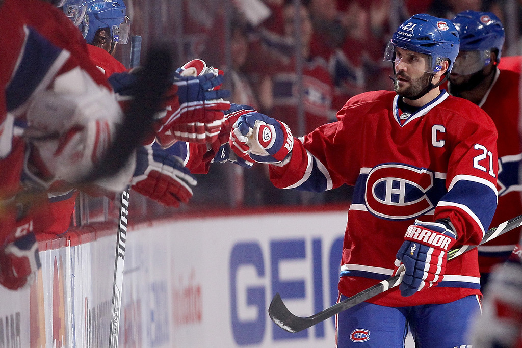 . MONTREAL, QC - MAY 17:  Brian Gionta #21 of the Montreal Canadiens celebrates with teammates after teammate Rene Bourque #17 scores a second period goal against the New York Rangers in Game One of the Eastern Conference Finals of the 2014 NHL Stanley Cup Playoffs at the Bell Centre on May 17, 2014 in Montreal, Canada.  (Photo by Bruce Bennett/Getty Images)
