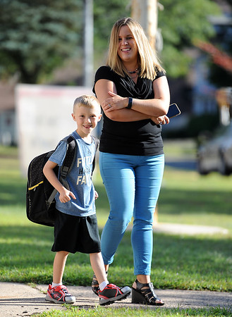 8/29/2019 Mike Orazzi | Staff Julie Casey and her son Noah arrive at the Derynoski Elementary School on Southington's first day back this year.
