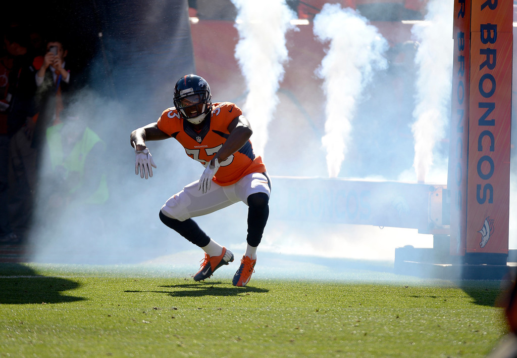 . Denver Broncos strong safety Duke Ihenacho (33) runs onto the field before the game.   (Photo by John Leyba/The Denver Post)