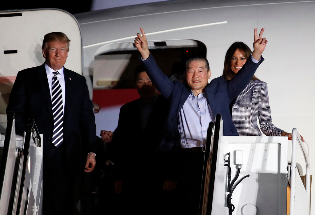 . President Donald Trump and first lady Melania Trump greet former North Korean detainee Kim Dong Chul, raising his arms, upon his arrival with two other former detainees, Tony Kim and Kim Hak Song, behind Kim Dong Chul, Thursday, May 10, 2018, at Andrews Air Force Base, Md. The three Korean-Americans were greeted by Trump beneath a giant American flag after they returned to the mainland U.S. early Thursday. (AP Photo/Alex Brandon)