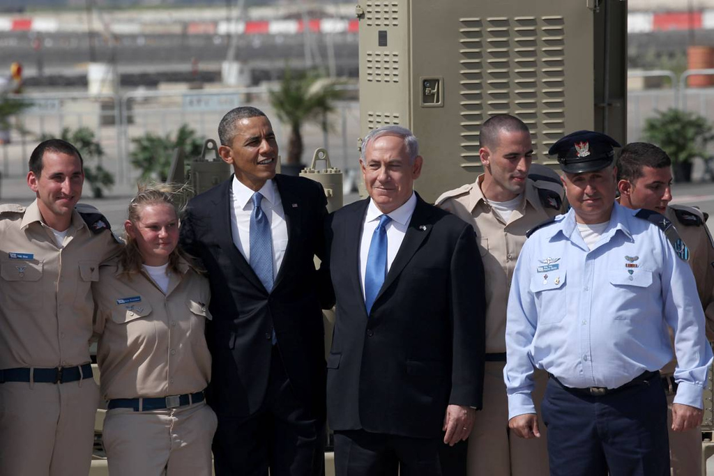 . U.S. President Barack Obama (3L) is greeted by Israeli Prime Minister Benjamin Netanyahu (C) during an official welcoming ceremony on his arrival at Ben Gurion International Airport on March, 20, 2013 near Tel Aviv, Israel. (Photo by Marc Israel Sellem-Pool/Getty Images)