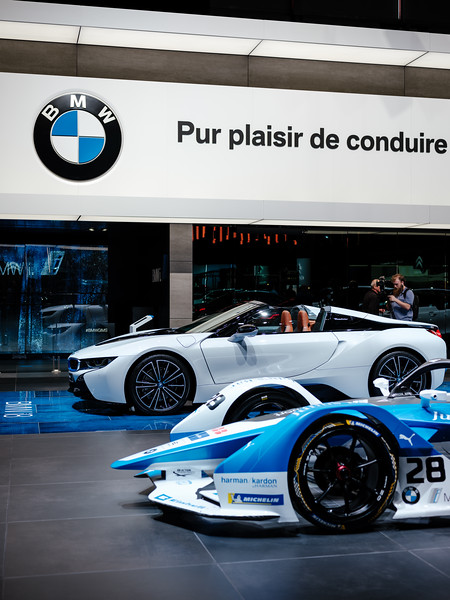 The BMW iFE.18 (Formula E) in front of the BMW i8 Roadster - Samuel Zeller for the New York Times