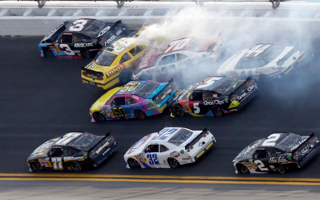 . NASCAR drivers crash in an eleven car pile-up late in the NASCAR Nationwide Series DRIVE4COPD 300 race at the Daytona International Speedway in Daytona Beach, Florida February 23, 2013. The Daytona 500 NASCAR Sprint Cup race is scheduled for February 24. REUTERS/Pierre Ducharme