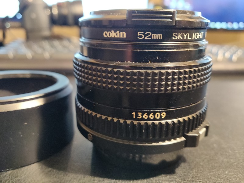 Canon FD 50 mm 2.0 - Serial X1105 & 136609 004.jpg