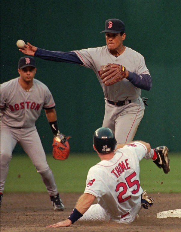 . Boston Red Sox second baseman Wil Cordero throws over sliding Cleveland Indians runner Jim Thome (25) to complete a double play on Indians batter Sandy Alomar in the second inning Friday, April 19, 1996, in Cleveland. Red Sox shortstop John Valentin, background, fielded Alomar\'s ground ball to start the twin killing. (AP Photo/Mark Duncan)