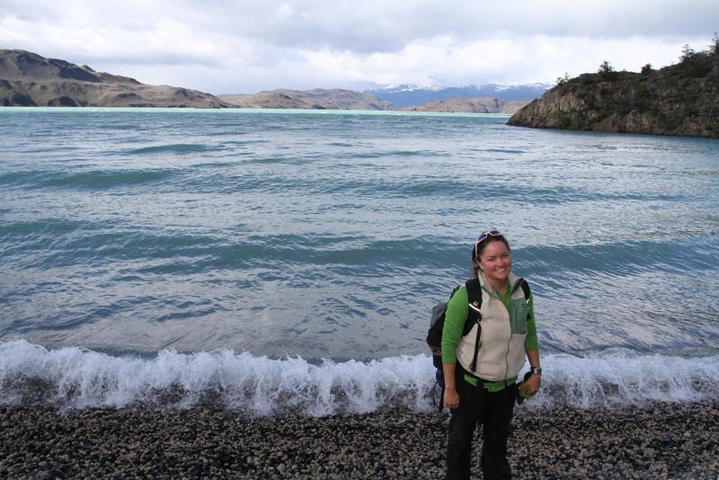 Brigitt on the edge of Lake Pehoe in Torres del Paine National Park