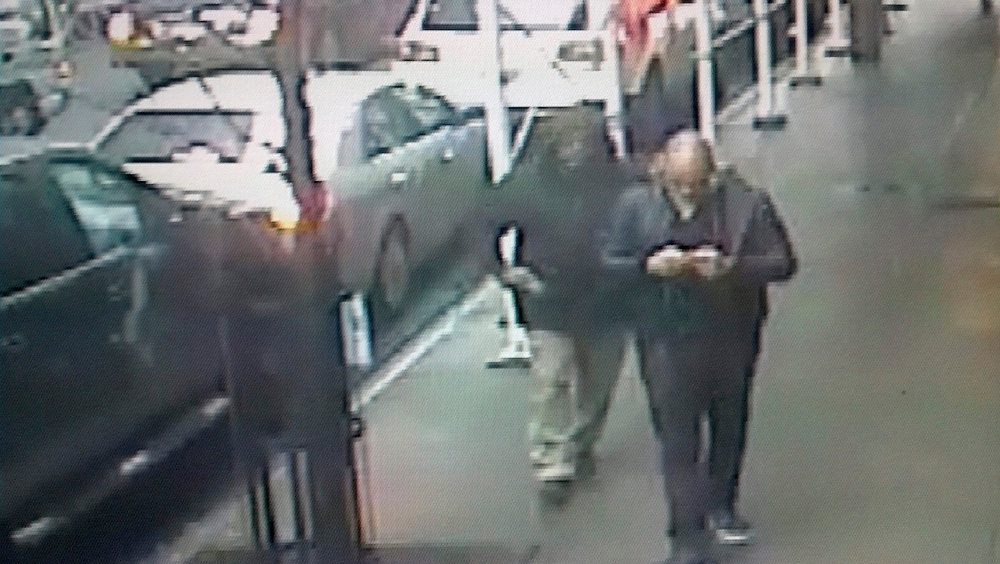 . This still image made from a video provided by the New York City Police Department shows the gunman, left, behind Brandon Lincoln Woodard pulling the weapon from his jacket pocket a moment before the shooting, Mon. Dec. 10, 2012 in New York. A security camera photo shows a man pulling a weapon from his pocket moments before police say he shot a Los Angeles man in midtown Manhattan. The NYPD released the photo Tuesday amid a manhunt for the unidentified suspect in the execution-style slaying (Ap Photo/New York Police Department/ HO)