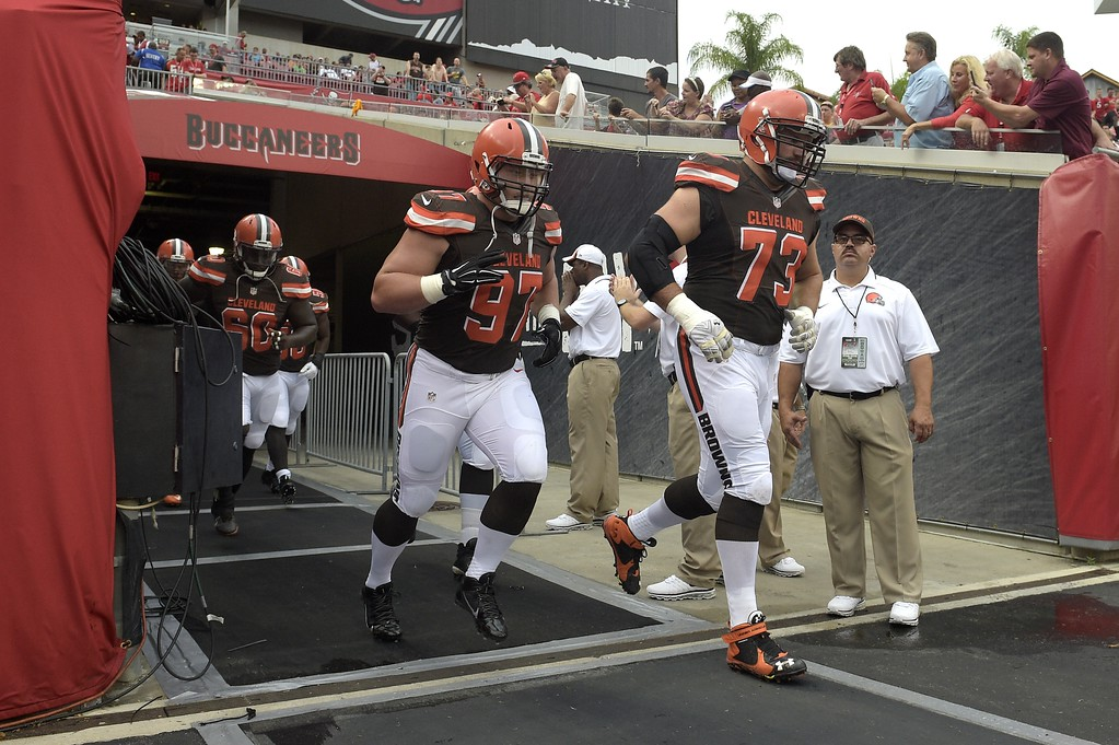 . Cleveland Browns defensive tackle Dylan Wynn (97) and tackle Joe Thomas (73) jog onto the field before a preseason NFL football game against the Tampa Bay Buccaneers in Tampa, Fla., Saturday, Aug. 29, 2015. (AP Photo/Phelan M. Ebenhack)