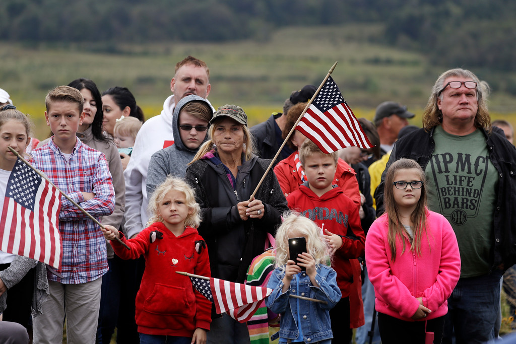 . Audience members attend the September 11th Flight 93 Memorial Service, Tuesday, Sept. 11, 2018, in Shanksville, Pa. President Donald Trump is marking 17 years since the worst terrorist attack on U.S. soil by visiting the Pennsylvania field that became a Sept. 11 memorial.  (AP Photo/Evan Vucci)
