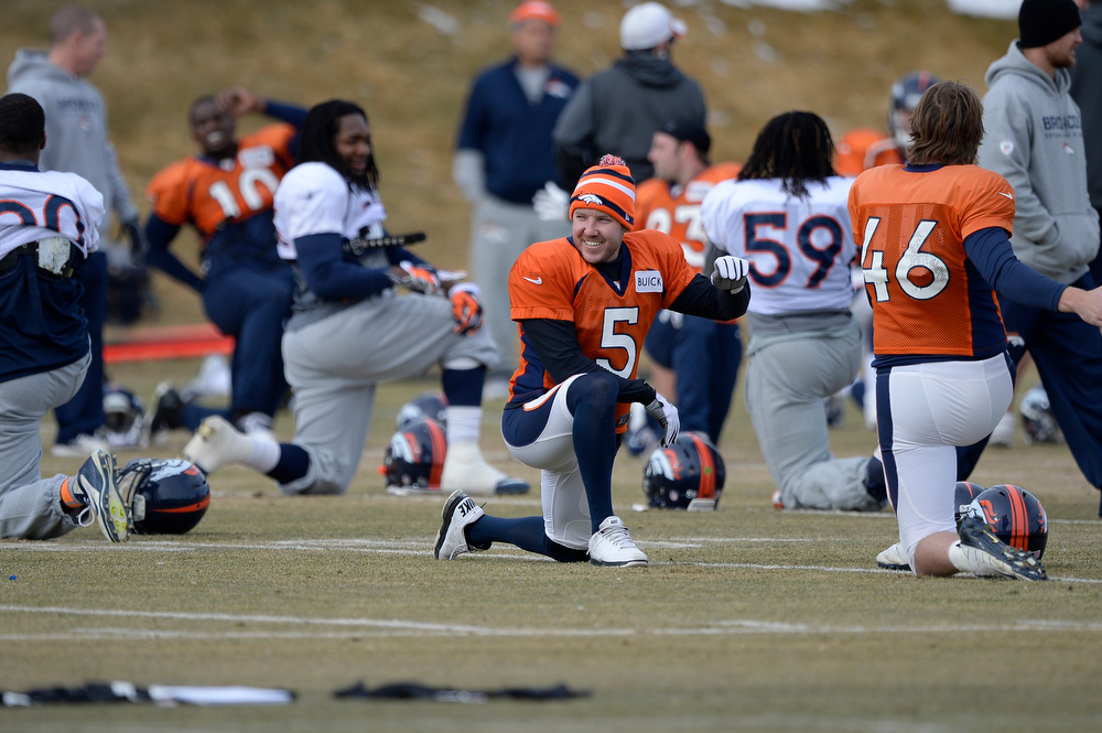. Denver Broncos kicker Matt Prater (5) smiles as he stretches before practice January 15, 2014 at Dove Valley. The Broncos are preparing for their game against the New England Patriots in the AFC championship game.  (Photo by John Leyba/The Denver Post)