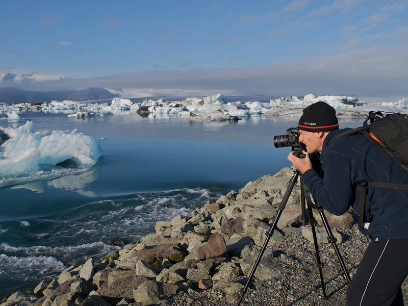 Me shooting with the E5. The spectacular Jokulsarlon lagoon on the south east side of Iceland. Naturally created by the glacier meltwater from Vatnajokull, which is Europe's largest glacier. The lagoon is full of floating icebergs such as this which are constantly moving. Extremely dangerous too and quite common for them to topple over. As such nobody is allowed to moor up and walk on them. This place was the setting for the James Bond (Pierce Brosnan) film 'Die Another Day' in 2002. The lagoon was deliberately blocked off from the sea (which it connects) for 6 weeks in February in order to prevent salt water inflow (the lagoon is 50/50 salt/fresh water). The lagoon was then closed off for 2 weeks to allow the saltwater to sink thus leaving the freshwater on top to freeze. Once the lagoon was filmed filming commenced :-)