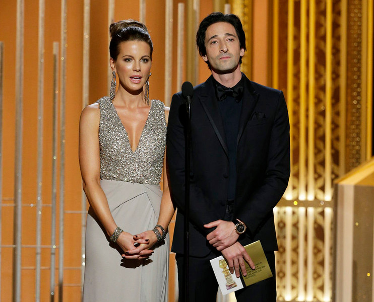 . In this image released by NBC, Kate Beckinsale, left, and Adrien Brody present an award at the 72nd Annual Golden Globe Awards on Sunday, Jan. 11, 2015, at the Beverly Hilton Hotel in Beverly Hills, Calif. (AP Photo/NBC, Paul Drinkwater)
