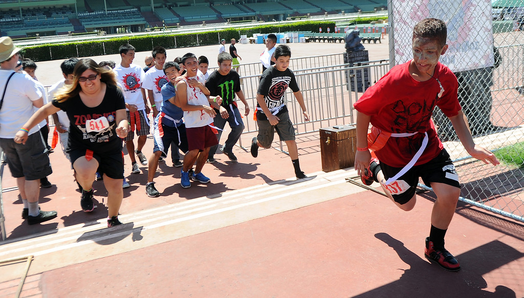 . Twelve year-old Ryan Fernandez of West Covina starts the race during the Zombie Blood Run at Santa Anita Park on Saturday, Aug. 17, 2013 in Arcadia, Calif. The American Red Cross San Gabriel Pomona Valley chapter is partnering with the Zombie Blood Run to prepare the San Gabriel Valley for a disaster, even a zombie apocalypse.  (Keith Birmingham/Pasadena Star-News)