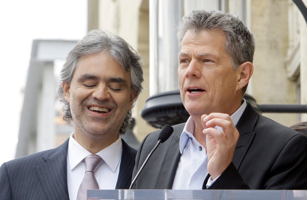 . Italian tenor Andrea Bocelli,  left, listens as music impresario David Foster praises him at dedication ceremonies for Bocelli\'s star on the Hollywood Walk of Fame in Los Angeles Tuesday, March 2, 2010. (AP Photo/Reed Saxon)