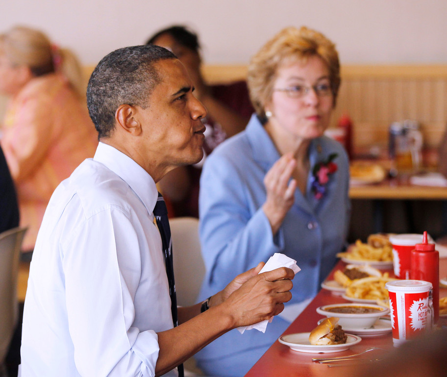. President Barack Obama and Rep. Marcy Kaptur, D-Ohio eat during an unannounced visit to Rudy\'s Hot Dog in Toledo, Ohio, Friday, June 3, 2011. (AP Photo/Charles Dharapak)