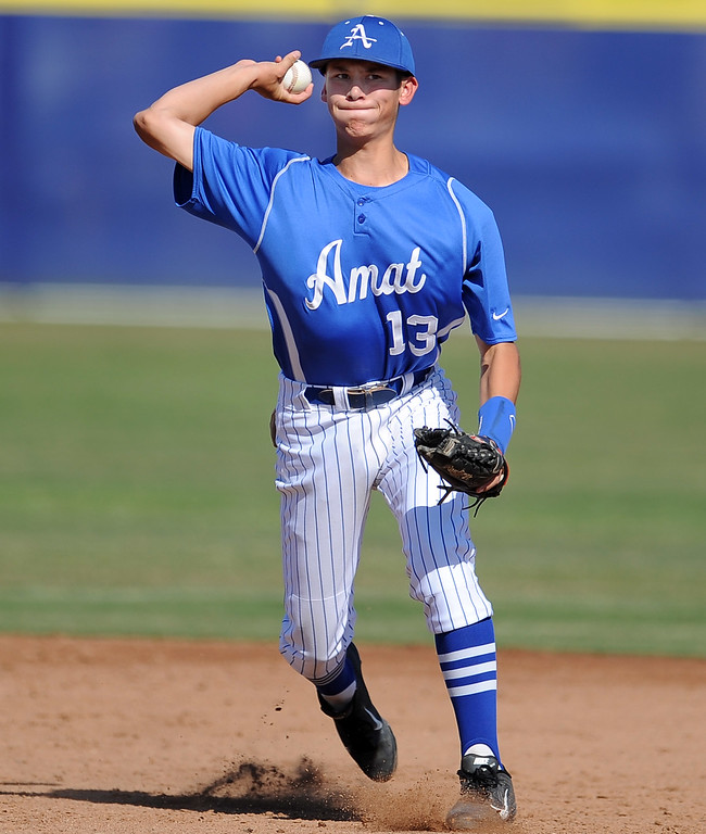 . Bishop Amat\'s Anthony Walters throws out St. Paul\'s Aaron Pinto (not pictured) in the third inning of a prep baseball game at Bishop Amat High School on Friday, April 19, 2012 in La Puente, Calif. Bishop Amat won 3-2.    (Keith Birmingham/Pasadena Star-News)