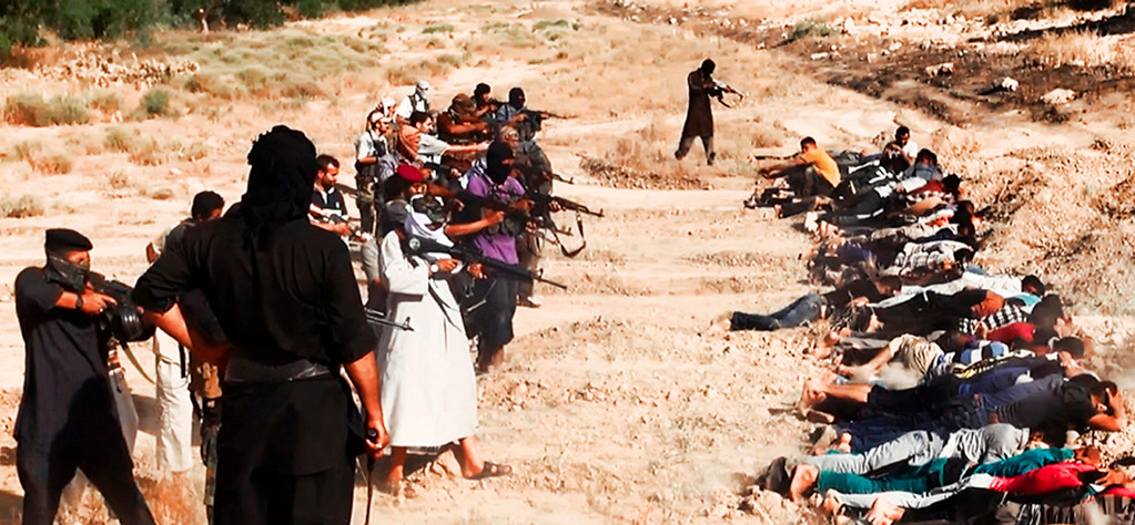 . This image posted on a militant website on Saturday, June 14, 2014, which has been verified and is consistent with other AP reporting, appears to show militants from the al-Qaida-inspired Islamic State of Iraq and the Levant (ISIL) taking aim at captured Iraqi soldiers wearing plain clothes after taking over a base in Tikrit, Iraq.  (AP Photo via militant website, File)