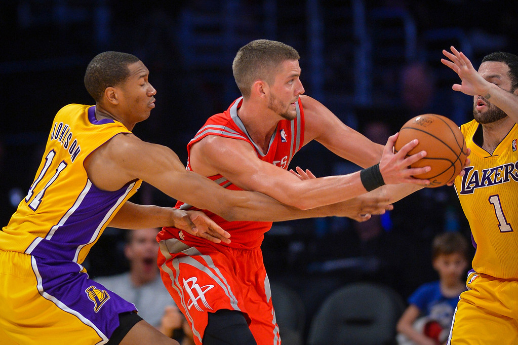 . Rockets Chandler Parsons looks for a pass as Lakers� Wesley Johnson and Jordan Farmar defend on the play  at Staples Center Wednesday, February 19, 2014.  The Rockets defeated the Lakers 134-108.  ( Photo by David Crane/Los Angeles Daily News )