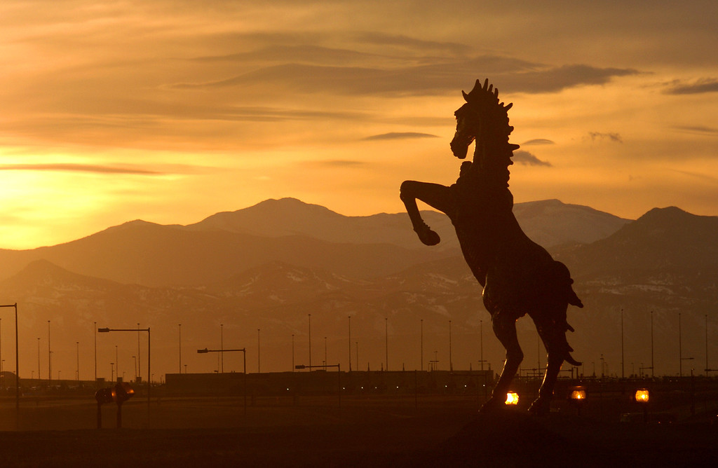 """. A 32-foot sculpture commissioned three years before Denver International Airport opened was finally installed  in the median of Pena Boulevard leading up to the terminal.  \""""Mustang\"""" was bolted onto a concrete base.  Creation of the sculpture survived lawsuits over the pace of the work, the illness of sculptor Luis Jimenez, and his death when a section of the sculpture came loose from a hoist and pinned him against a steel support beam.  Jimenez was 65 when he died at his Hondo, N.M., studio in June 2006. His family, including sons Adan and Orion, finished the sculpture, his widow Susan Jimenez said.  Helen H. Richardson/The Denver Post"""