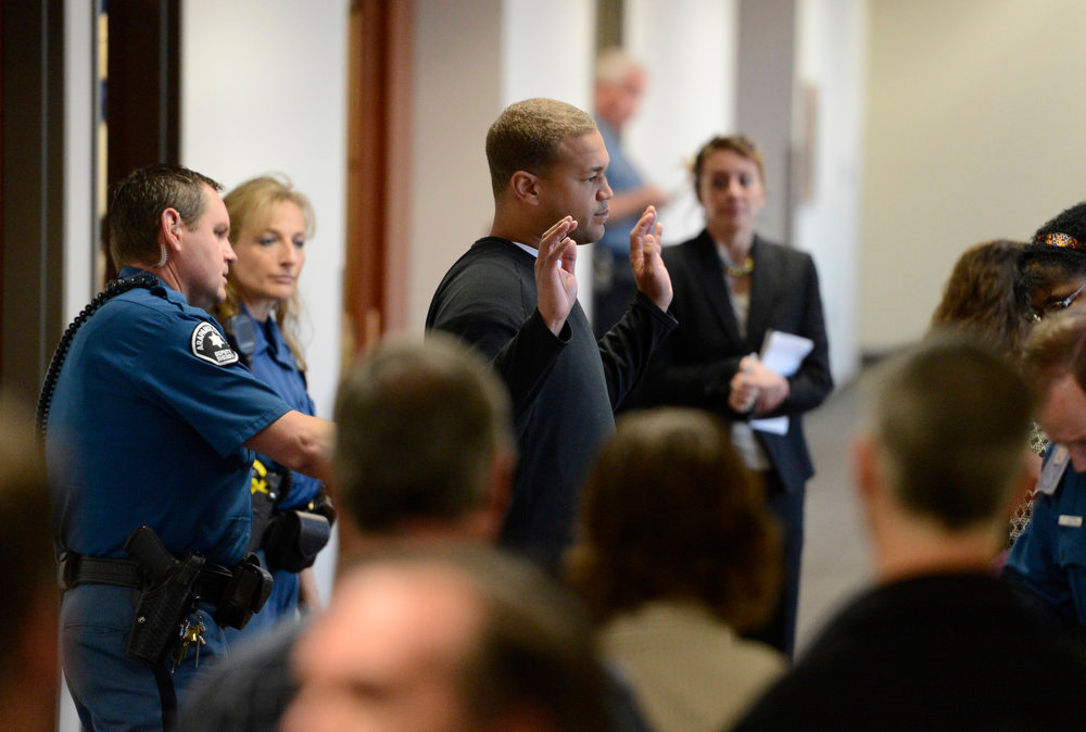 Description of . Aurora theater shooting victim Marcus Weaver goes through security as he arrives at court, Monday April 01, 2013. The prosecution will go for the death penalty against the Aurora theater shooting suspect James Holmes. (Photo By RJ Sangosti/The Denver Post)